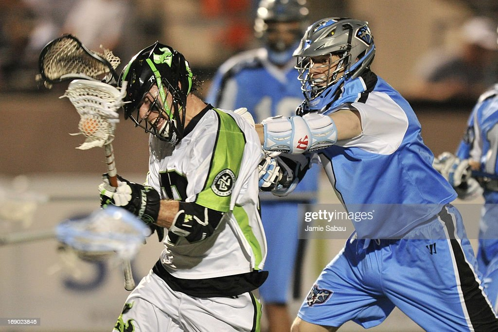David Earl #33 of the New York Lizards is slashed by Brett Garber #3 of the Ohio Machine in the fourth period on May 18, 2013 at Selby Stadium in Delaware, Ohio. New York defeated Ohio 14-8.