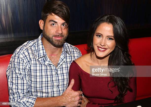 David Eason and girlfriend Jenelle Evans enjoy the 'Tomahawk Steak' as they visit Planet Hollywood Times Square on November 20 2015 in New York City