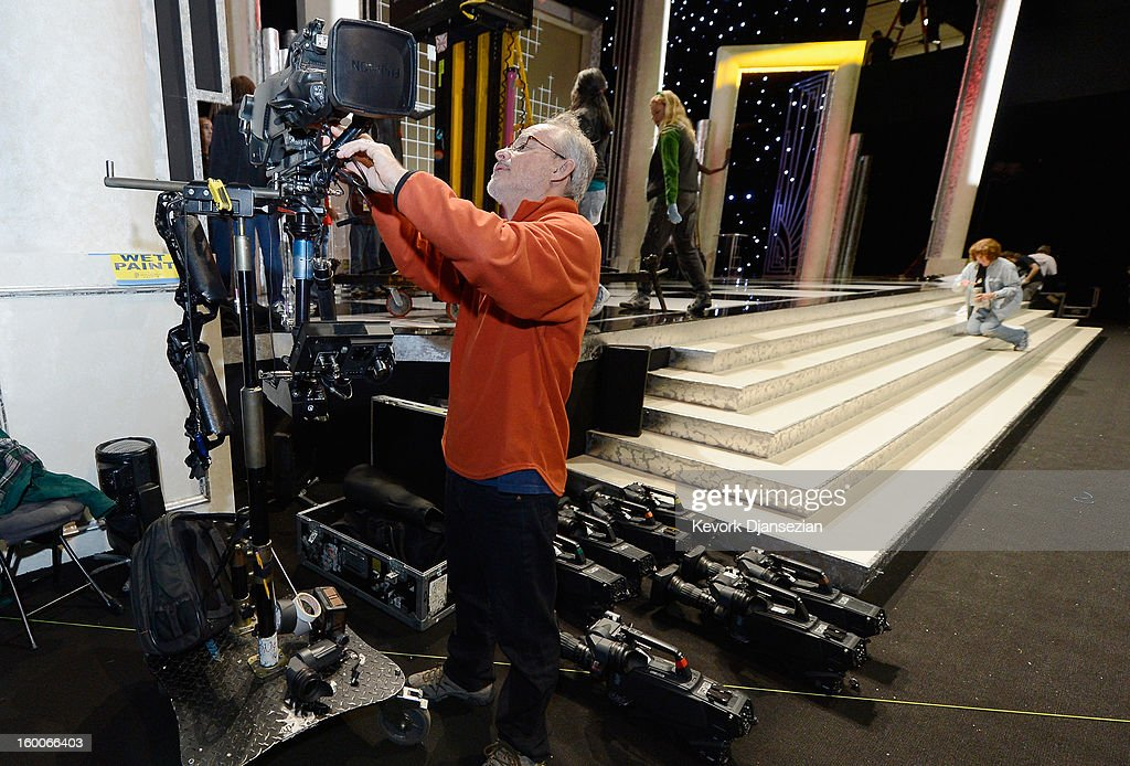 David Eastwood sets up cameras as workers continue to build the stage and the ballroom during the 19th Annual Screen Actor Guild Awards ceremony behind the scenes event at The Shrine Auditorium on January 25, 2013 in Los Angeles, California.
