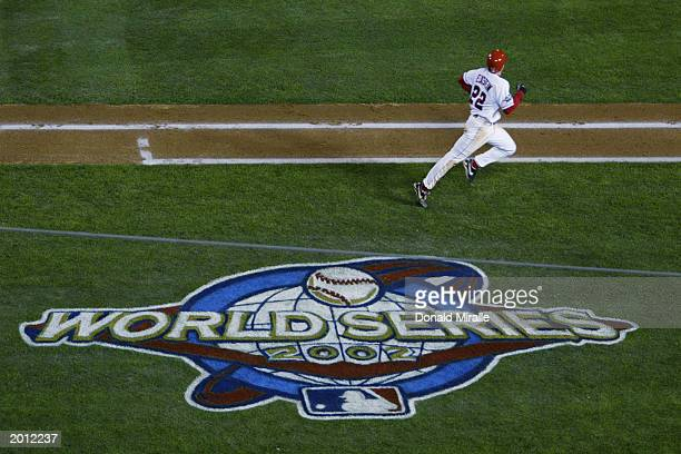 David Eckstein of the Anaheim Angels runs for home plate against the San Francisco Giants in front of the World Series logo painted on the grass in...