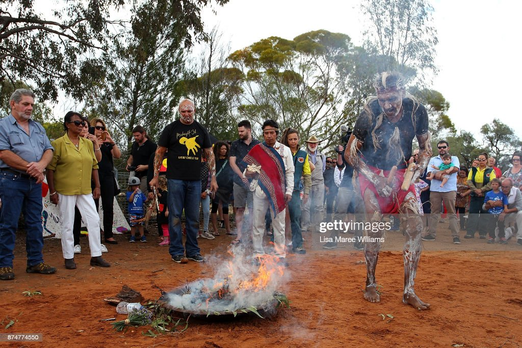David Edwards a Mutthi Mutthi Elder welcomes Mungo Man back to country during a smoking ceremony on November 16, 2017 in Balranald, Australia. The ancestors of Australia's oldest human, the Mungo Man, and the traditional owners of the Willandra area in which his remains were found over 40 years ago, are on a journey to return the remains to country at Lake Mungo in southwestern New South Wales. The Mungo Man and 100 ancestors are being carried in an restored Aboriginal 'hearse' used in the 1970's and 80's and making long journey from the Australian National University in Canberra, to their final resting place with stops in Wagga Wagga, Hay and Balranald where traditional owners will hold ceremonies and pay respects. The decision to move the remains to the ANU in 1974 was unpopular with the Muthi Muthi, the Ngiyampaa and the Paakantyi people, the traditional owners and ancestors, who fought for 40 years until a decision was made in 2015 to repatriate the remain