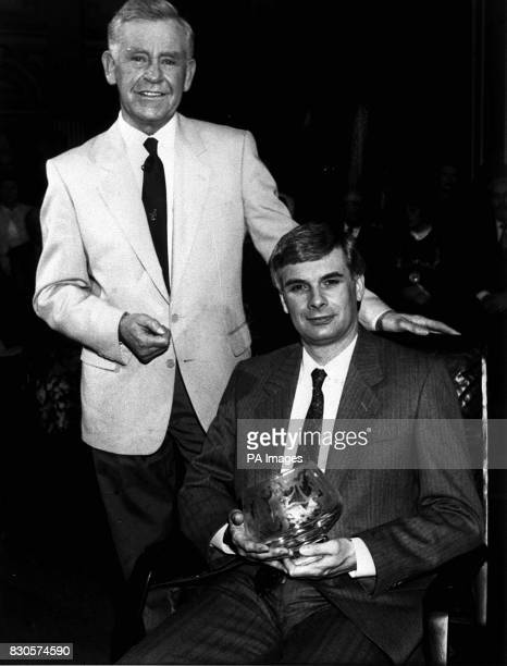 David Edwards taking the mastermind 1990 title after nail biting final at the glasgow city chambers He is pictured with magnus Magnusson holding the...