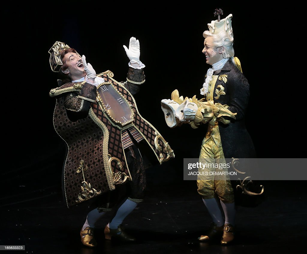 David Eguren and Dan Menasche respectively play 'Big Ben' and 'Lumiere' during a dress rehearsal of 'the Beauty and the Beast The Broadway Musical'...
