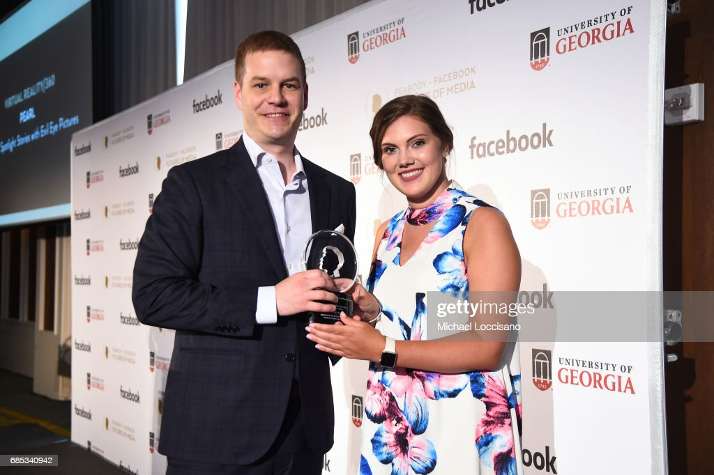 David Eisenmann accepts an award from Shelby Silverman on behalf of Pearl at the Peabody-Facebook Futures Of Media Awards at Hotel Eventi on May 19, 2017 in New York City.