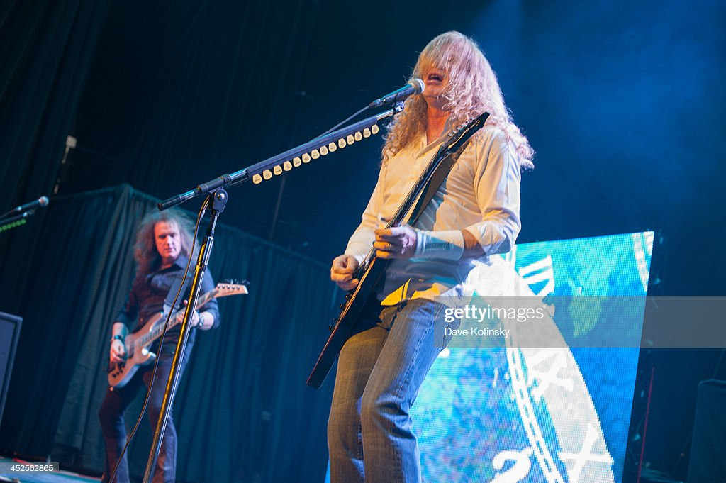 David Ellefson(L) and Dave Mustaine(R) of Megadeth performs at The Wellmont Theatre on November 29, 2013 in Montclair, New Jersey.
