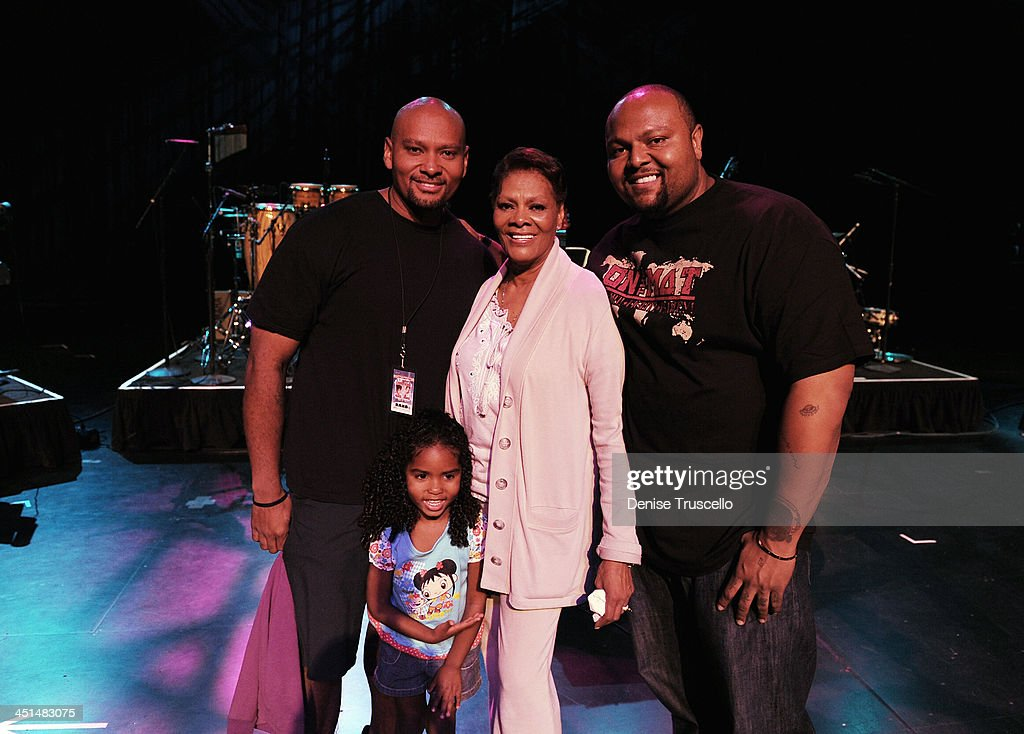 David Elliott, Lealand Elliott, Dionne Warwick and Damon Elliott pose for photos on stage during sound check for Eric Floyd's Grand Divas of Stage at the Las Vegas Hilton on May 21, 2010 in Las Vegas, Nevada.