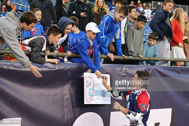 David Emala of the Boston Cannons signs autographs for fans following the game against the Denver Outlaws at Gillette Stadium on April 12 2015 in...