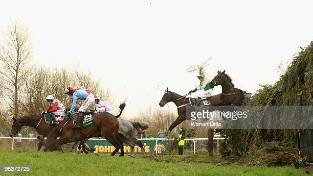 David England takes a fall on Ballyfitz at Becher's Brook during The John Smith's Grand National Steeple Chase at Aintree racecourse on April 10 2010...