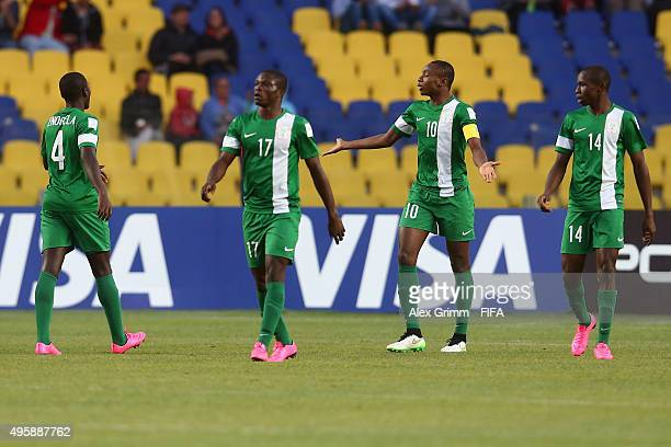 David Enogela Osinachi Ebere Kelechi Nwakali and Ejike Ikwu of Nigeria react after Kevin Magana of Mexico scored his team's first goal during the...