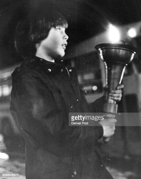 David Eskenazi of 3811 S Magnolia Way carries the Torch of Hanukkah along Speer Blvd Thursday night as part of the opening ceremonies for the...