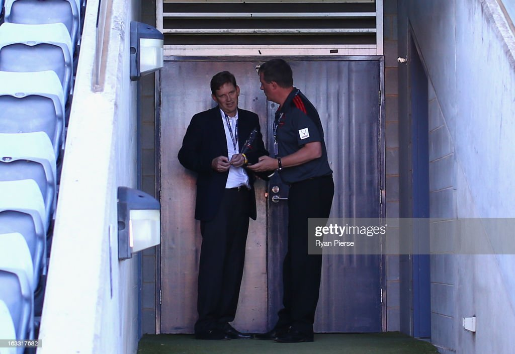 David Evans, Chairman of Essendon and Ian Robson, CEO of Essenson, talk before the round three of the NAB Cup AFL match between the Greater Western Sydney Giants and the Essendon Bombers at Manuka Oval on March 8, 2013 in Canberra, Australia.