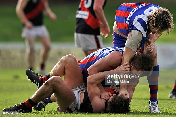 David Fanning of Port Melbourne deals Ben Duscher a blow during the round 12 VFL match between Port Melbourne and the Bendigo Bombers at TEAC Oval on...