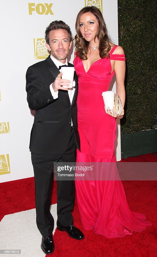 David Faustino (L) and guest attend the FOX Golden Globe after party held at the FOX Pavilion at the Golden Globes on January 13, 2013 in Beverly Hills, California.