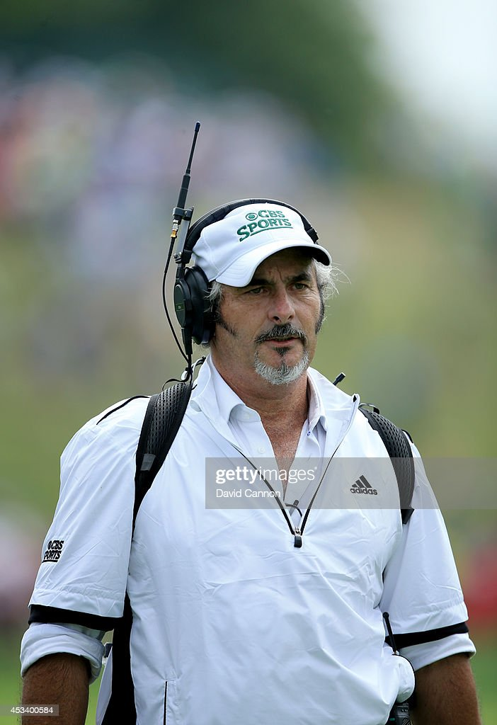 David Feherty of CBS Sports follows a player during the third round of the 96th PGA Championship at Valhalla Golf Club on August 9 2014 in Louisville...