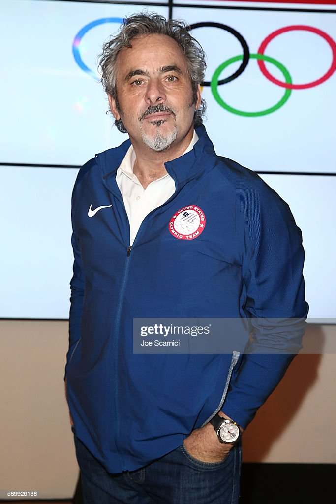 David Feherty poses with a Team USA jacket at the USA House at Colegio Sao Paulo on August 5, 2016 in Rio de Janeiro, Brazil.