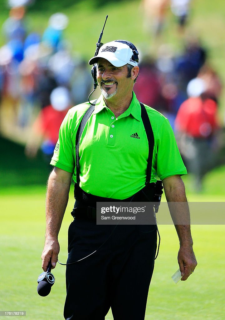David Feherty working for CBS Sports during the final round of the 95th PGA Championship at Oak Hill Country Club on August 11 2013 in Rochester New...