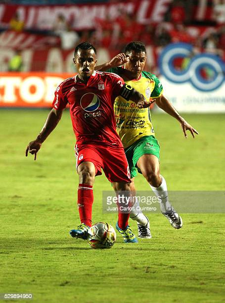 David Ferreira of America and Martin Arzuaga of Real Cartagena fight for the ball during a match between America de Cali and Real Cartagena as part...