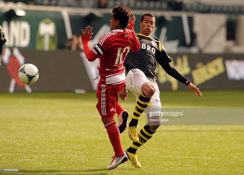 David Ferreira #10 of FC Dallas battles for a ball with Robin Quaison #15 of AIK during the first half of the game at Jeld-Wen Field on February 17, 2013 in Portland, Oregon.
