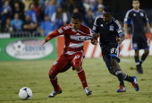 David Ferreira of FC Dallas fights for control of the ball with Marvin Chavez of the San Jose Earthquakes during the first half of an MLS Soccer game...