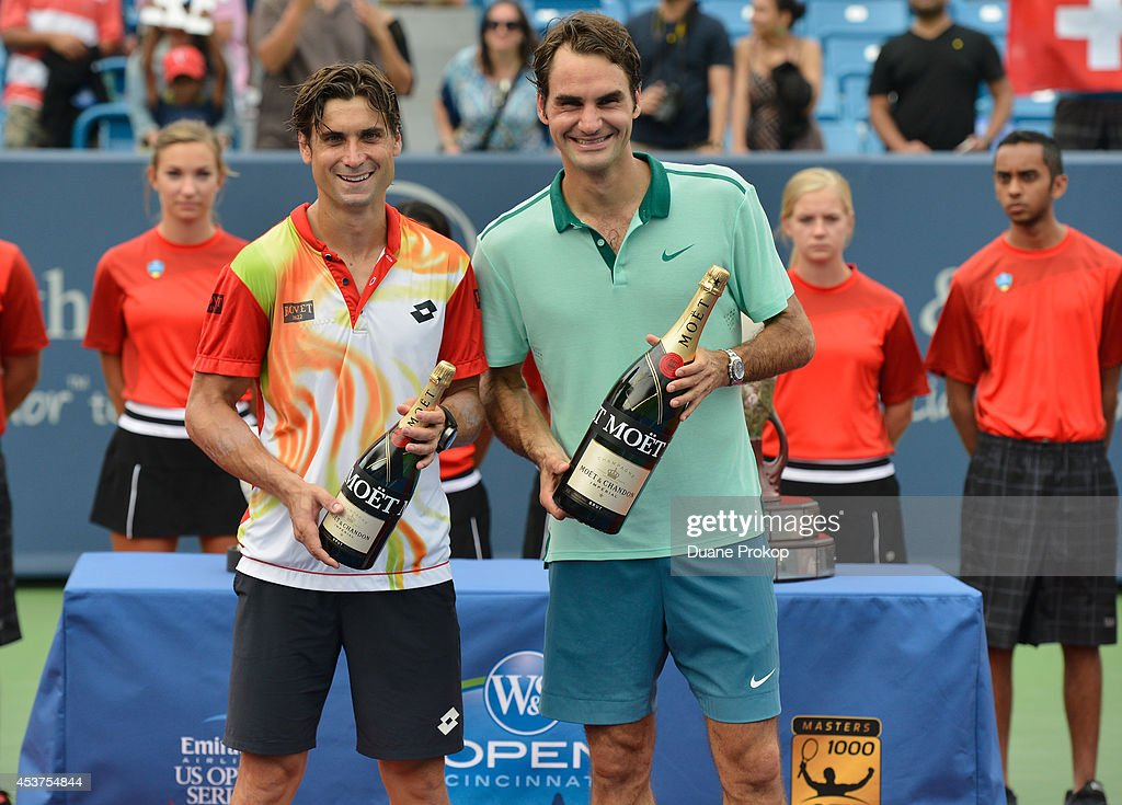 David Ferrer (L) and Roger Federer celebrate with Moet & Chandon, the official champagne of the Western & Southern Open, following Federers victory of the men's finals at Linder Family Tennis Center on August 17, 2014 in Mason, Ohio.