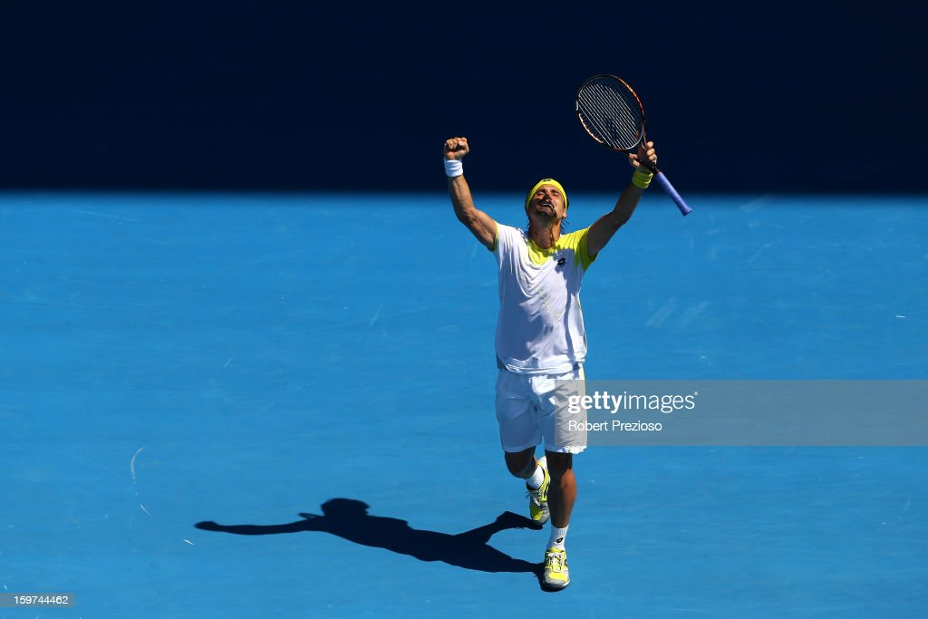 David Ferrer celebrates winning his fourth round match against Kei Nishikori of Japan during day seven of the 2013 Australian Open at Melbourne Park on January 20, 2013 in Melbourne, Australia.