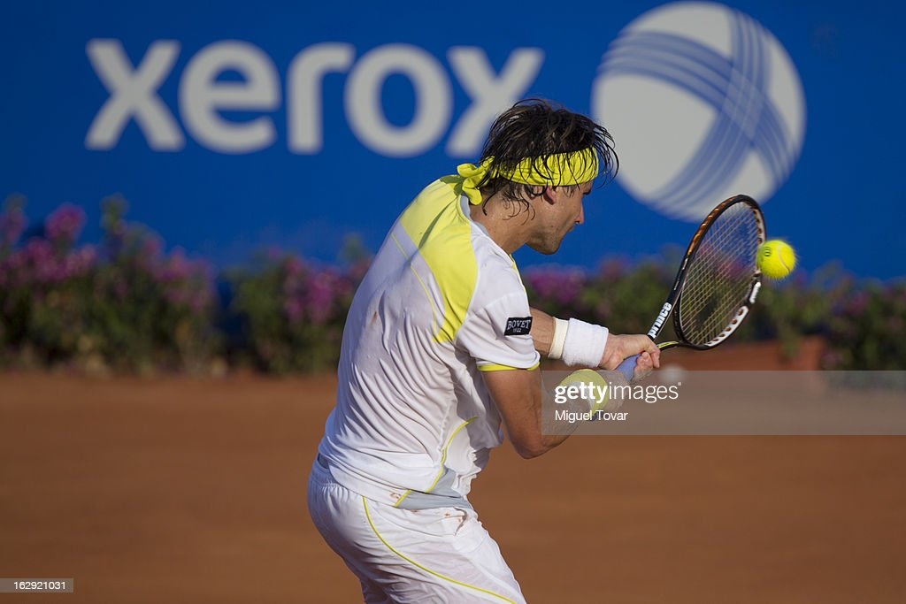<a gi-track='captionPersonalityLinkClicked' href=/galleries/search?phrase=David+Ferrer&family=editorial&specificpeople=208197 ng-click='$event.stopPropagation()'>David Ferrer</a> from Spain in action during a tennis match against Paolo Lorenzi from Italy as part of the ATP Mexican Open Tennis at Pacific Resort on February 28, 2013 in Acapulco, Mexico.
