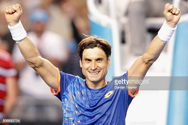 David Ferrer of celebrates winning his fourth round match against John Isner of the United States during day eight of the 2016 Australian Open at...