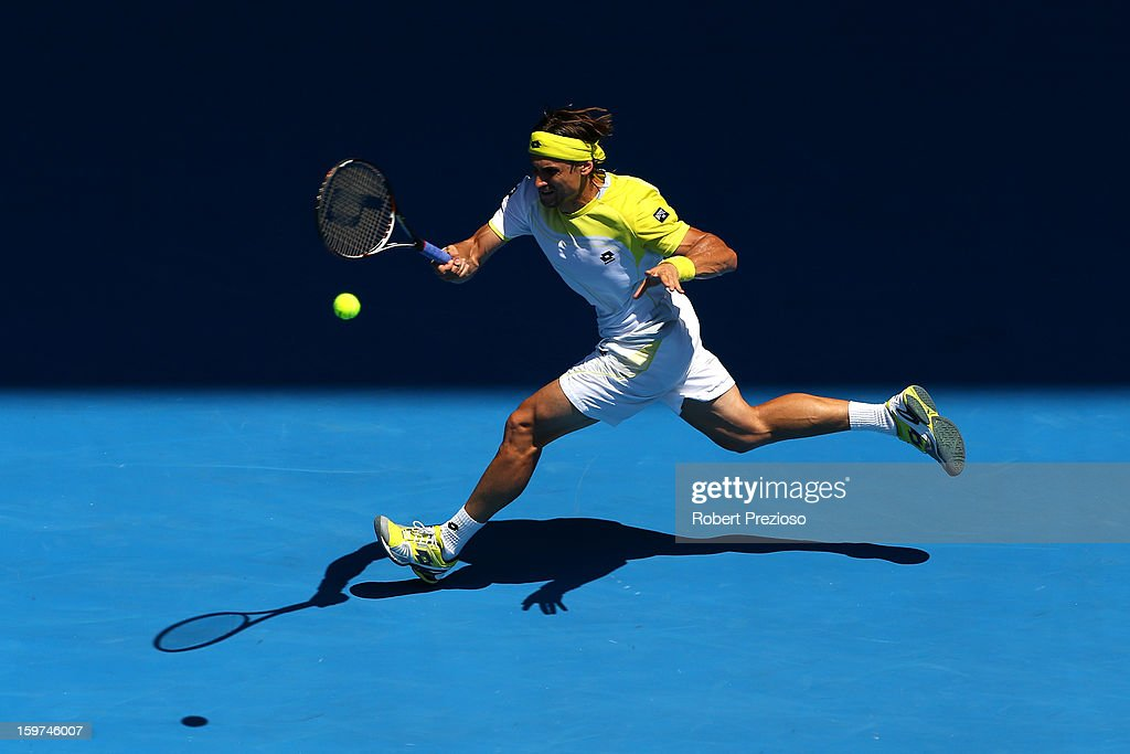 David Ferrer of of Spain plays a forehand in his fourth round match against Kei Nishikori of Japan during day seven of the 2013 Australian Open at Melbourne Park on January 20, 2013 in Melbourne, Australia.