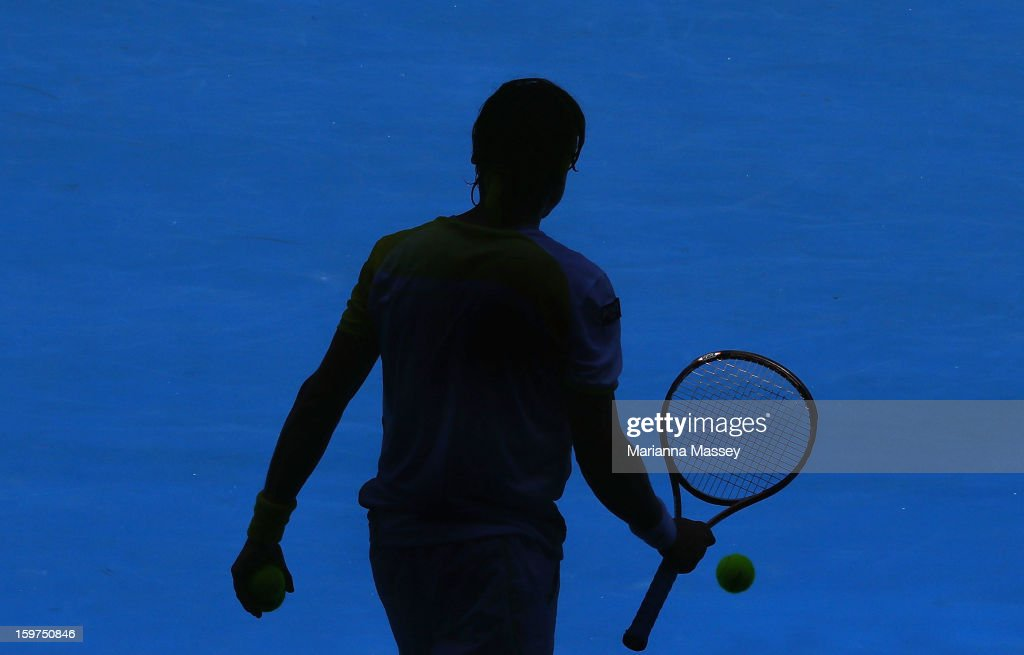 David Ferrer of of Spain prepares to serve in his fourth round match against Kei Nishikori of Japan during day seven of the 2013 Australian Open at Melbourne Park on January 20, 2013 in Melbourne, Australia.