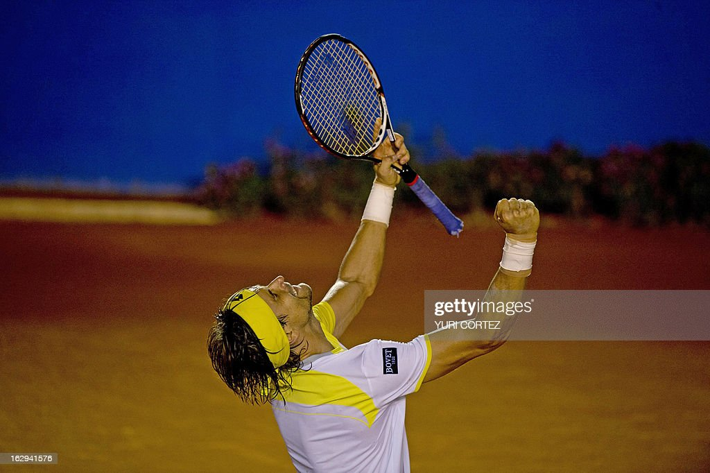 David Ferrer of Spain celebrates after defecting Fabio Fognini of Italy during their semi-final Mexico ATP Open men's single tennis match, in Acapulco, Guerrero state on March 1, 2013. AFP PHOTO/ Yuri CORTEZ