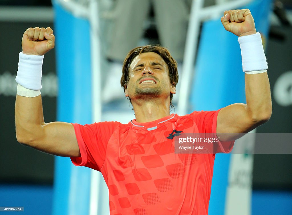David Ferrer of Spain celebrates after winning his third round match against Gilles Simon of France during day six of the 2015 Australian Open at Melbourne Park on January 24, 2015 in Melbourne, Australia.Ê