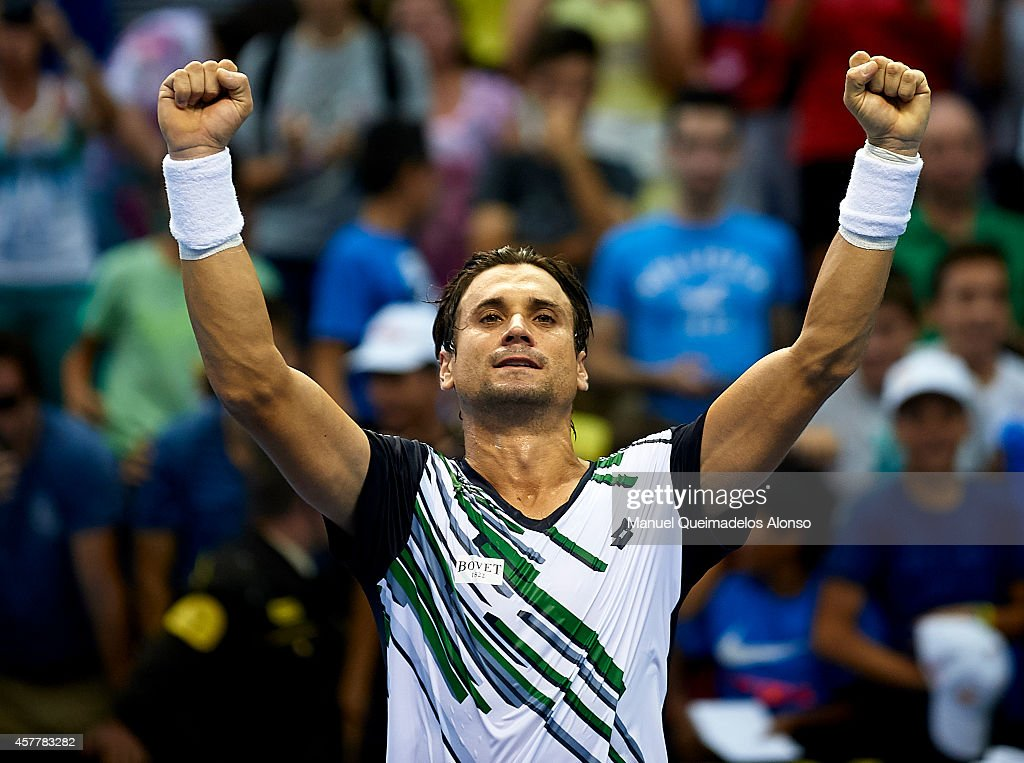David Ferrer of Spain celebrates defeating Thomaz Bellucci of Brazil during day five of the ATP 500 World Tour Valencia Open tennis tournament at the Ciudad de las Artes y las Ciencias on October 24, 2014 in Valencia, Spain.