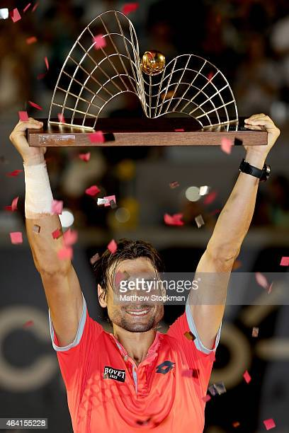 David Ferrer of Spain celebrates his win over Fabio Fognini of Italy during the final of the Rio Open at the Jockey Club Brasileiro on February 22...