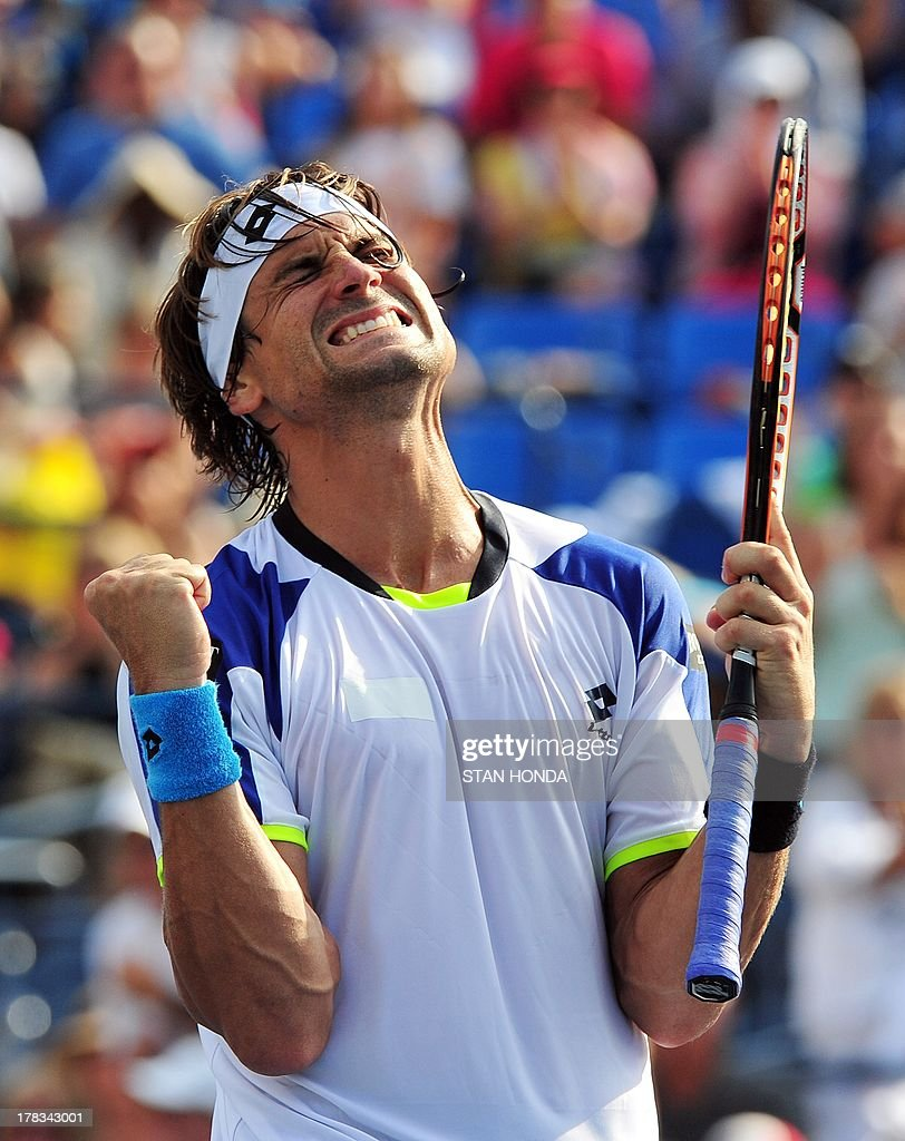 David Ferrer of Spain celebrates his win over Roberto Bautista Agut of Spain during their 2013 US Open men's singles match at the USTA Billie Jean King National Tennis Center August 29, 2013 in New York. Ferrer won, 6-3, 6-7, 6-1, 6-2. AFP PHOTO/Stan HONDA