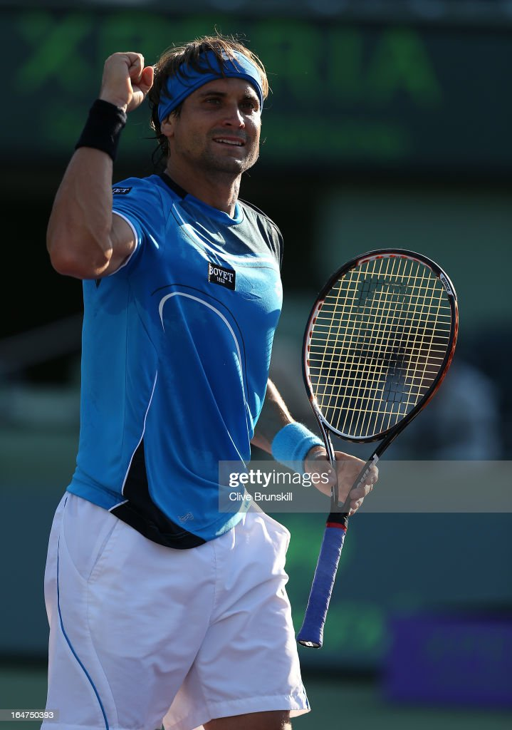 <a gi-track='captionPersonalityLinkClicked' href=/galleries/search?phrase=David+Ferrer&family=editorial&specificpeople=208197 ng-click='$event.stopPropagation()'>David Ferrer</a> of Spain celebrates match point against Jurgen Melzer of Austria during their quarter final match at the Sony Open at Crandon Park Tennis Center on March 27, 2013 in Key Biscayne, Florida.