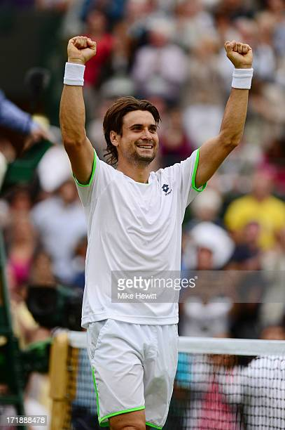 David Ferrer of Spain celebrates victory during the Gentlemen's Singles third round match against Alexandr Dolgopolov of Ukraine on day six of the...