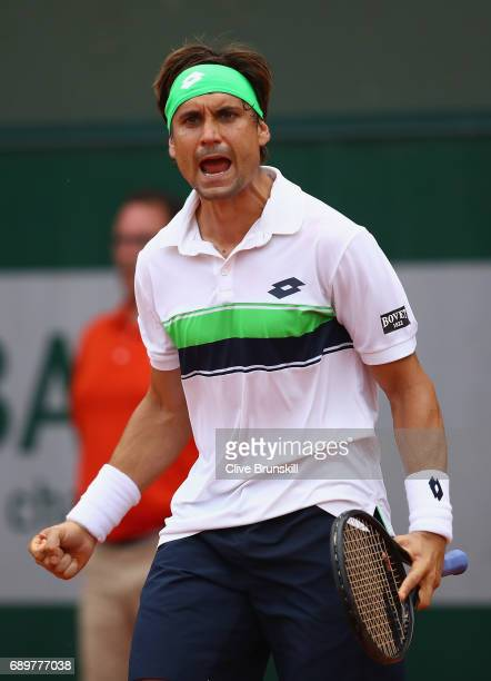 David Ferrer of Spain celebrates victory following the mens singles first round match against Donald Young of The United States on day two of the...