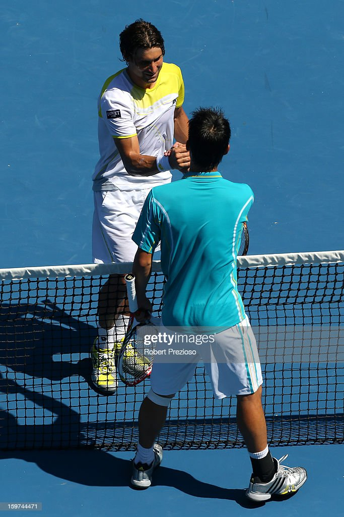 David Ferrer (top) of Spain celebrates winning his fourth round match against Kei Nishikori of Japan during day seven of the 2013 Australian Open at Melbourne Park on January 20, 2013 in Melbourne, Australia.