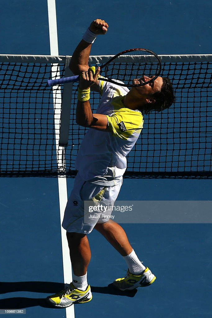 David Ferrer of Spain celebrates winning his quarterfinal match against Nicolas Almagro of Spain during day nine of the 2013 Australian Open at Melbourne Park on January 22, 2013 in Melbourne, Australia.