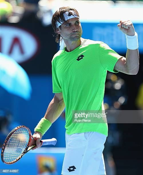 David Ferrer of Spain celebrates winning his third round match against Jeremy Chardy of France during day five of the 2014 Australian Open at...
