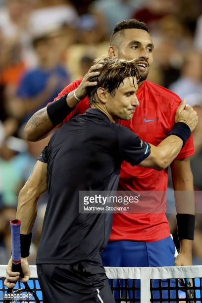 David Ferrer of Spain congratulates Nick Kyrgiuos of Australia after their match during day 8 of the Western Southern Open at the Lindner Family...