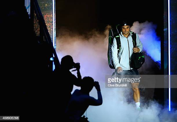 David Ferrer of Spain enters the court for the round robin singles match againstKei Nishikori of Japan on day five of the Barclays ATP World Tour...