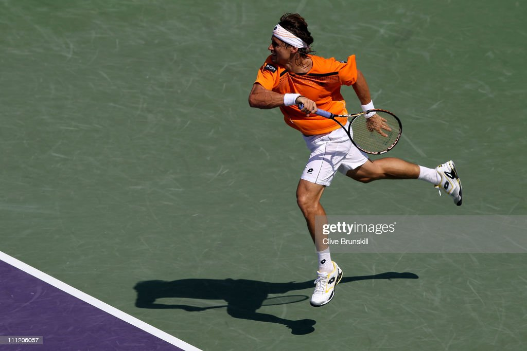 <a gi-track='captionPersonalityLinkClicked' href=/galleries/search?phrase=David+Ferrer&family=editorial&specificpeople=208197 ng-click='$event.stopPropagation()'>David Ferrer</a> of Spain follows through on a return against Mardy Fish during the Sony Ericsson Open at Crandon Park Tennis Center on March 30, 2011 in Key Biscayne, Florida.