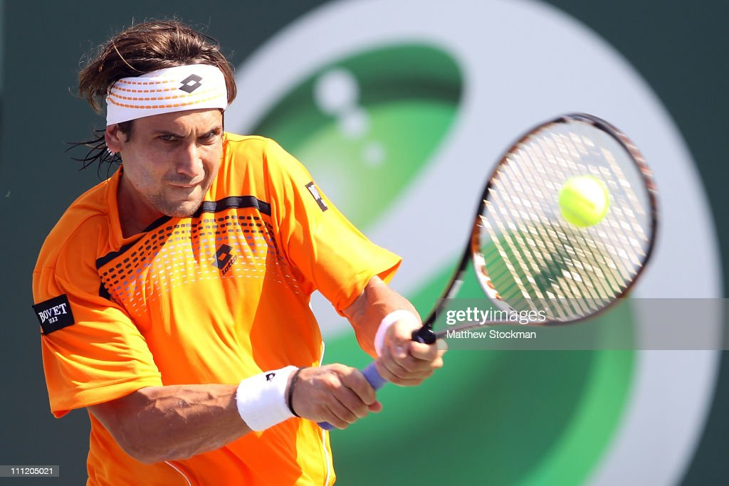 <a gi-track='captionPersonalityLinkClicked' href=/galleries/search?phrase=David+Ferrer&family=editorial&specificpeople=208197 ng-click='$event.stopPropagation()'>David Ferrer</a> of Spain hits a backhand return against Mardy Fish during the Sony Ericsson Open at Crandon Park Tennis Center on March 30, 2011 in Key Biscayne, Florida.