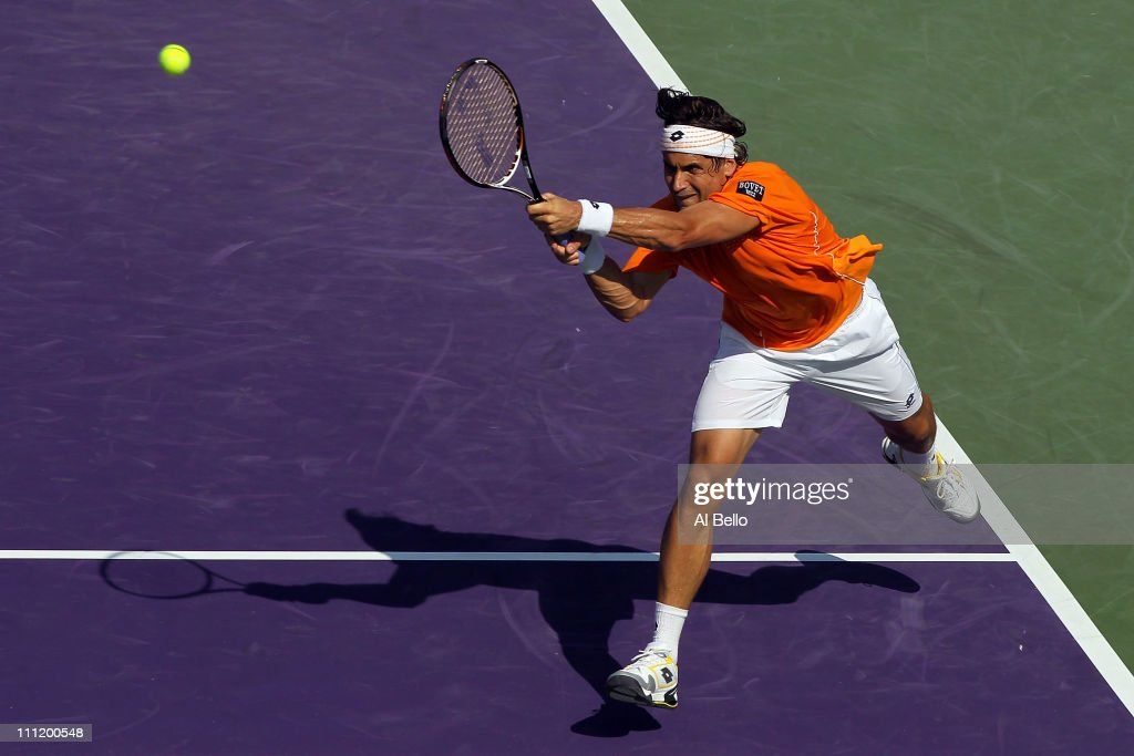 <a gi-track='captionPersonalityLinkClicked' href=/galleries/search?phrase=David+Ferrer&family=editorial&specificpeople=208197 ng-click='$event.stopPropagation()'>David Ferrer</a> of Spain hits a backhand return Mardy Fish during the Sony Ericsson Open at Crandon Park Tennis Center on March 30, 2011 in Key Biscayne, Florida.