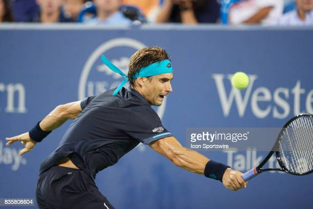David Ferrer of Spain hits a backhand to Nick Kyrgios of Australia during their semifinal match in the Western Southern Open at the Lindner Family...