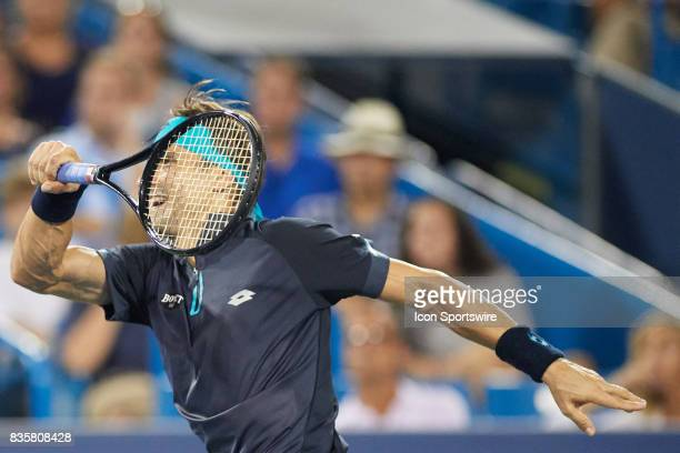 David Ferrer of Spain hits a forehand to Nick Kyrgios of Australia during their semifinal match in the Western Southern Open at the Lindner Family...
