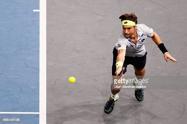 David Ferrer of Spain in action against Alexandr Dolgopolov of Ukraine during Day 2 of the BNP Paribas Masters held at AccorHotels Arena on November...