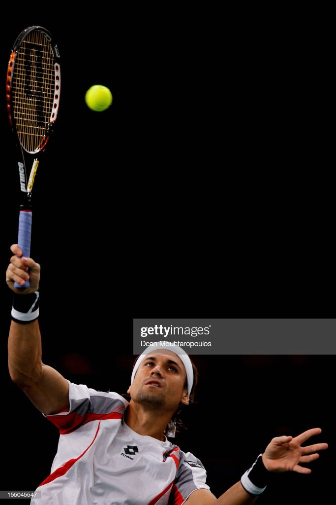 <a gi-track='captionPersonalityLinkClicked' href=/galleries/search?phrase=David+Ferrer&family=editorial&specificpeople=208197 ng-click='$event.stopPropagation()'>David Ferrer</a> of Spain in action against Marcel Granollers of Spain during day 3 of the BNP Paribas Masters at Palais Omnisports de Bercy on October 31, 2012 in Paris, France.