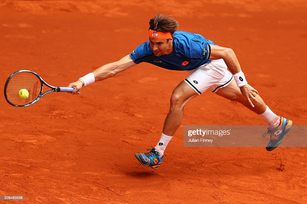 David Ferrer of Spain in action against Tomas Berdych of Czech Republic during day six of the Mutua Madrid Open tennis tournament at the Caja Magica on May 05, 2016 in Madrid, Spain.